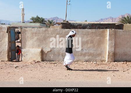 EGYPT - FEBRUARY 2: Bedouin man walking in the street on February 2, 2011 in Dahab, Egypt. - Stock Photo