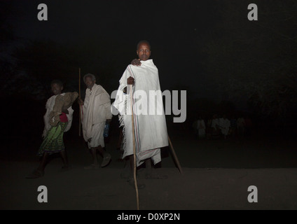 Night Shot Of Karrayyu Tribe People In Traditional Clothes During Gadaaa Ceremony, Metahara, Ethiopia - Stock Photo