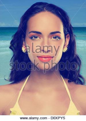 Young woman wearing yellow bikini and earrings - Stock Photo