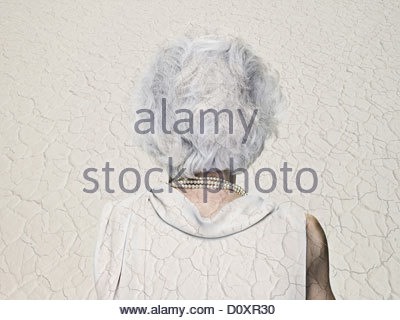 Senior woman double exposed with an arid landscape - Stock Photo