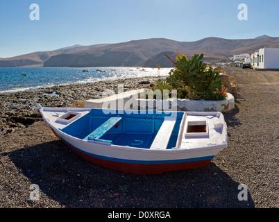 Spain, Lanzarote, Playa Quemada, Fishing dinghy, city, village, water, summer, mountains, sea, Canary Islands, - Stock Photo