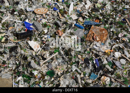 Broken glass and other debris at waste management site - Stock Photo