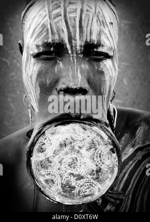 Black And White Portrait Of A Mursi Tribe Woman With Lip Plate And Enlarged Ears In Mago National Park, Omo Valley, - Stock Photo