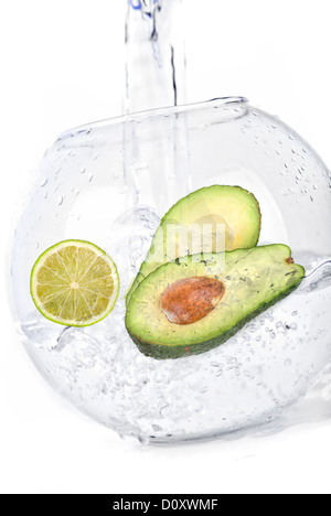 limes in water avocado - Stock Photo