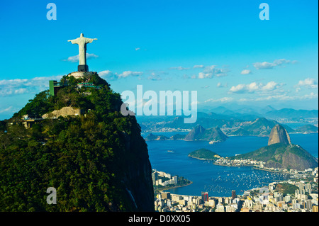 Christ the Redeemer statue overlooking Rio de Janeiro and Sugarloaf Mountain, Brazil - Stock Photo