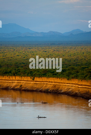 Boats Crossing Omo River With Mountains In The Background, Omo Valley, Ethiopia - Stock Photo