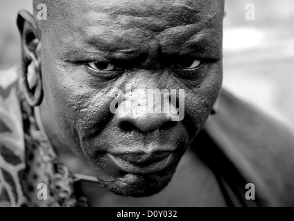 Black and white portrait of surma tribe warrior with enlarged ears tulgit omo valley