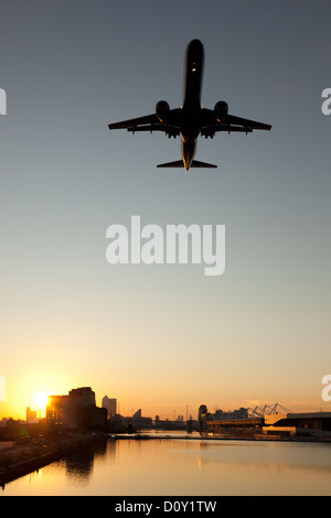 an airplane on its final approach to London City Airport - Stock Photo