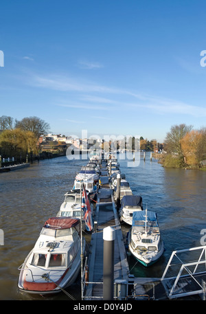 boats moored on the river thames at teddington, middlesex, england, seen from teddington bridge - Stock Photo