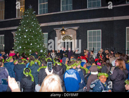 3 December 2012, London; X-Factor finalists and David Cameron help switch the Downing Street Christmas lights on - Stock Photo