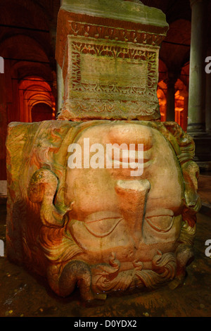 Upside down stone head of Medusa in the underground Basilica Cistern of Istanbul Turkey - Stock Photo
