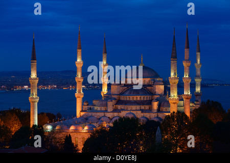 Blue Mosque with lights at dusk on the Bosphorus Sultanahmet Istanbul Turkey - Stock Photo