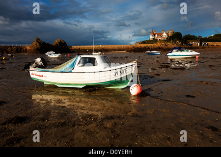 Boats at low tide on beach at La Rocque, Jersey, Channels Islands, UK - Stock Photo