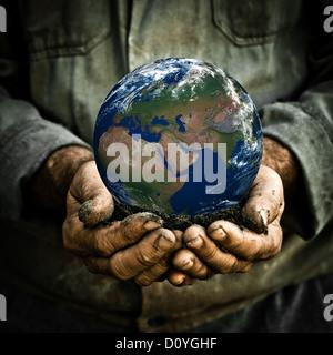 Man holding Earth - Stock Photo