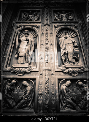 Russian Orthodox reliefs on the bronze doors of St. Isaac's Cathedral in St. Petersburg, Russia. - Stock Photo