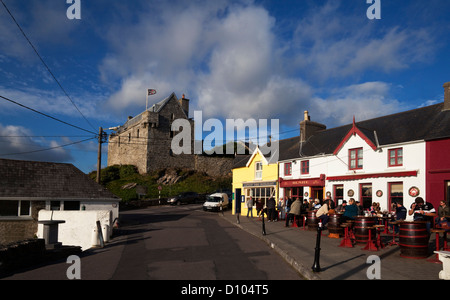 Street Scene with Dún na Séad Castle, built in 1215, Baltimore, County Cork, Ireland - Stock Photo