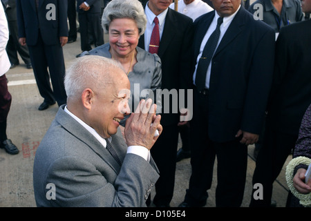 Retired King Norodom Sihanouk and Queen Norodom Monineath arrive at Phnom Penh Airport. - Stock Photo
