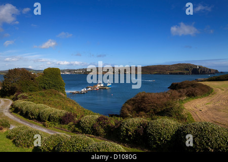 The distant Baltimore Beacon and Jetty, Sherkin Island, County Cork, Ireland - Stock Photo
