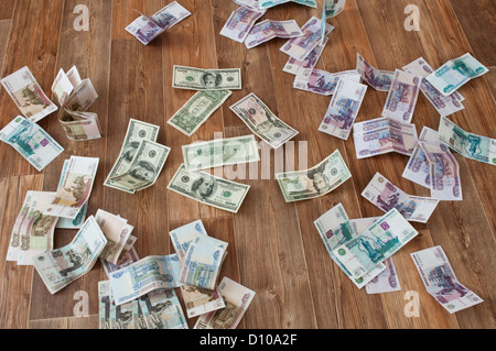 dollar and ruble banknotes scattered on the floor - Stock Photo