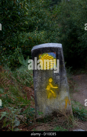 scallop shell and pilgrim on cement post marks the camino, the French Route otherwise known as the Way of St. James - Stock Photo