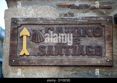Yellow Arrow points the way on the Camino de Santiago, the pilgrimage route known as the Way of St. James, Northern - Stock Photo