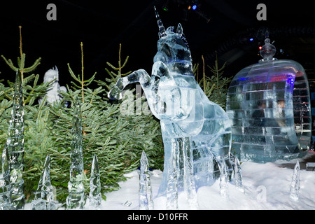 Carved Ice Sculpture Of A Unicorn Pulled-Carriage In The ice Kingdom At The Winter Wonderland Hyde Park London, - Stock Photo