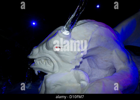Carved Ice Sculpture Of A Dragon In The ice Kingdom At The Winter Wonderland Hyde Park London, England, UK - Stock Photo
