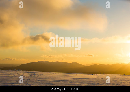 Looking South West towards the Coniston Fells from Helvellyn at sunset, Lake District, UK. - Stock Photo