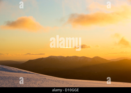 Looking South West towards the Coniston and Langdale Fells from Helvellyn at sunset, Lake District, UK. - Stock Photo
