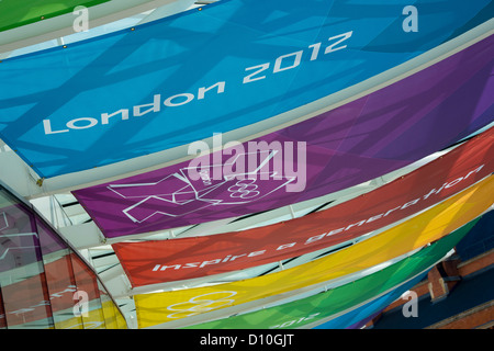 Colourful banners on display outside the entrance to the Kings Cross during the London 2012 Olympics. - Stock Photo