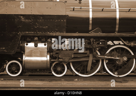 Steam train locomotive moving parts, gears and wheels in sepia - Stock Photo