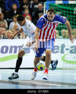 Kiel's Daniel Narcisse (L) and Madrid's Joan Canellas Reixach vie for the ball during the Handball Champions League - Stock Photo