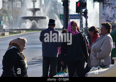 Bucharest, Romania, passersby on Unity Square (Piata Unirii) in Bucharest - Stock Photo