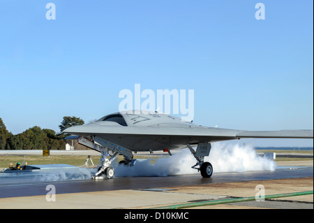 Launch crew prepares a X-47B Unmanned Combat Air System (UCAS) demonstrator for its first land-based catapult launch. - Stock Photo