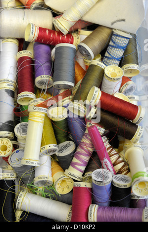Close up of box of coloured cotton reels - Stock Photo