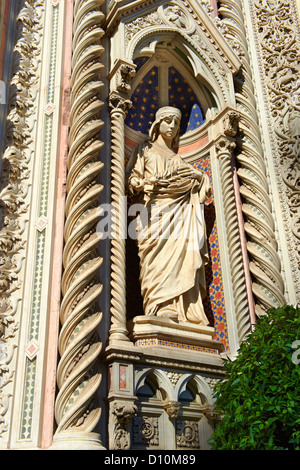 Statue of Saint Mary of the Flower on the outside of the Florence Duomo, Italy - Stock Photo