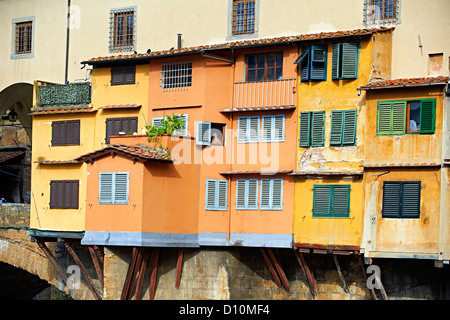 The Ponte Vecchio bridge with its shops spanning the Arno River, Florence Italy - Stock Photo