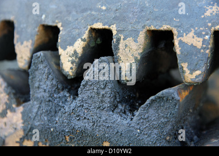 robust gear teeth with black industrial grease - Stock Photo