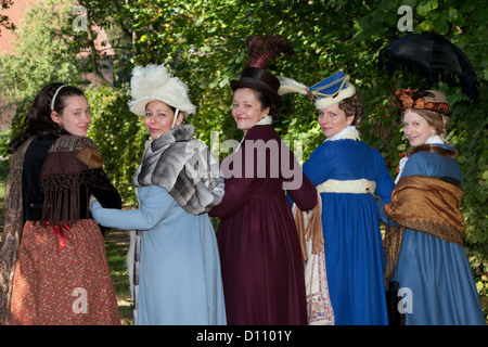 Five beautiful ladies in 19th-century attire in Jena, Germany - Stock Photo