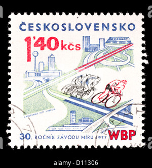 Postage stamp from Czechoslovakia depicting cyclists. - Stock Photo