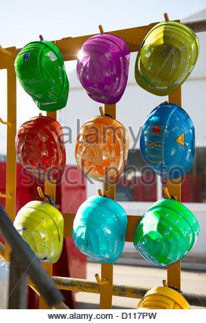 Multicoloured Hard Hats - Stock Photo