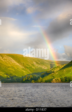 A rainbow provides a scenic backdrop to Ullswater, near Howtown Jetty in England's Lake District. - Stock Photo