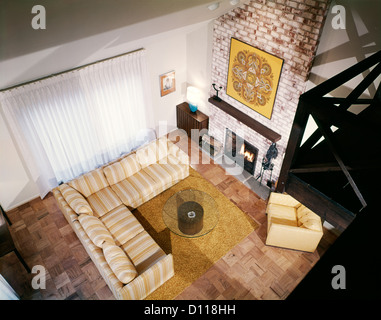 1960s INTERIOR FAMILY ROOM VIEW FROM ABOVE IN LOFT - Stock Photo