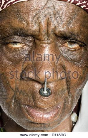 mozambique elderly woman facial scarring scar scars scarification scarifying old senior seniors active 70s 80s 70 - Stock Photo