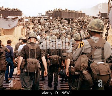 1960s 1965 ARRIVAL OF U.S. ARMY SOLDIERS IN VIETNAM 1ST CAVALRY DIVISION AIRMOBILE AS THEY LAND ON BEACH - Stock Photo
