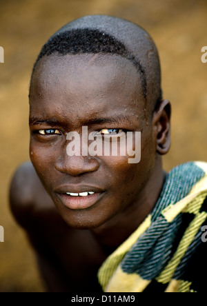 Portrait Of A Bodi Tribe Man With Shaved Head, Hana Mursi, Ethiopia - Stock Photo