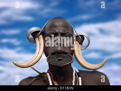 Portrait Of A Mursi Tribe Woman With Lip Plate And Enlarged Ears In Mago National Park, Omo Valley, Ethiopia - Stock Photo
