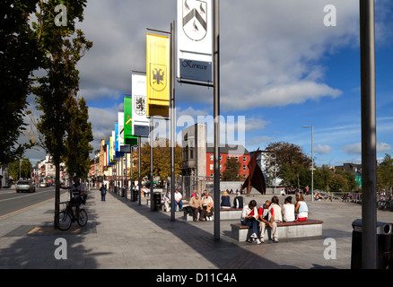 Galway family banners lining Kennedy Park in Eyre Square, Galway City, Ireland - Stock Photo