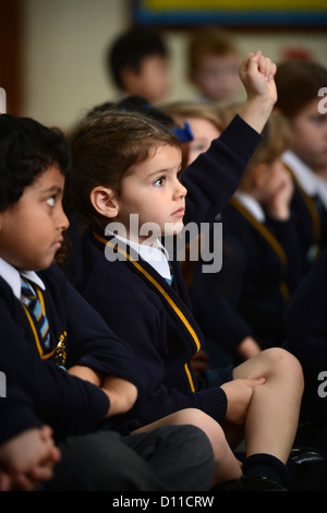 Children in morning assembly at Our Lady & St. Werburgh's Catholic Primary School in Newcastle-under-Lyme, Staffordshire - Stock Photo