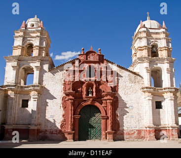 Historic Santa Barbara catholic church with ornate entrance and doorway in village of Huancavelica in Peru, South - Stock Photo
